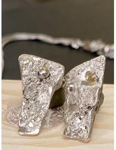 Création artisanale en argent rhodié. Boucle d'oreille pour femme vendu en ligne ou dans notre bijouterie de Mont St André