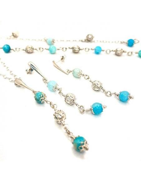 collier,bracelets,boucles d'oreilles artisanales exhibant le bleu étrange des hémimorphites.